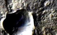 Thaumasia Fossae Crater