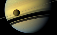PIA 14922 Saturn and Titan: Colorful Colossuses and Changing Hues